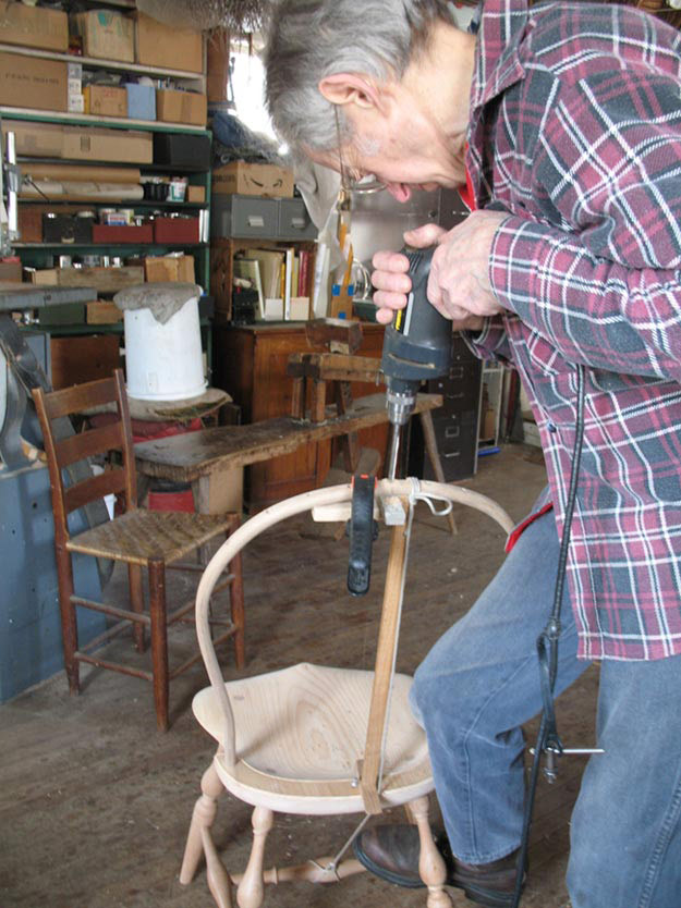 Sawyer Drills A Mortise In The Bow For The Center Spindle By Eye, Without  The Assistance Of A Jig.Photo By The Author.