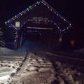 Pittsburgh, NH. A classic backroad covered bridge, decked in holiday lights. Credit: Deborah